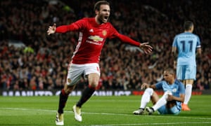 Manchester United's Juan Mata celebrates scoring their first goal and the United crowd are pretty happy too.