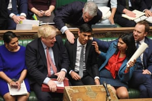 Pats on the back for Chancellor Rishi Sunak, after delivering his Budget in the House of Commons, 11 March