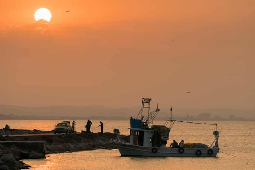 A fishing boat and fishermen at Sinop, Turkey