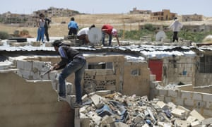 Refugees demolish their makeshift shelters in Arsal.