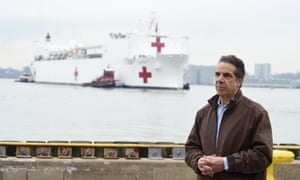 New York governor Andrew Cuomo pictured in front of the USNS Comfort, a US Navy hospital ship.