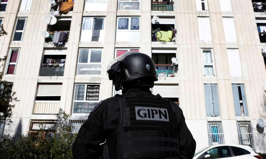 French police seal off the Castellane housing estate in Marseille after hooded gunmen opened fire on a police car.