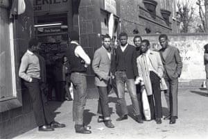 Kenlock's childhood friends meet near a Brixton market. c1975
