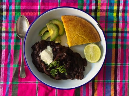Felicity Cloake's perfect veg chilli, served with cornbread and avocado.