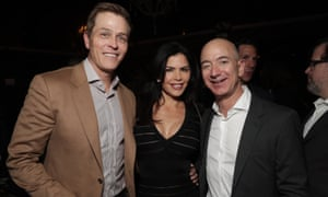 Patrick Whitesell, Lauren Sanchez and Jeff Bezos at a party in Los Angeles.