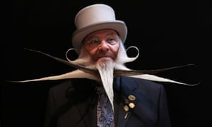 A participant of the World Beard and Moustache Championships poses before taking part in Antwerp, Belgium.