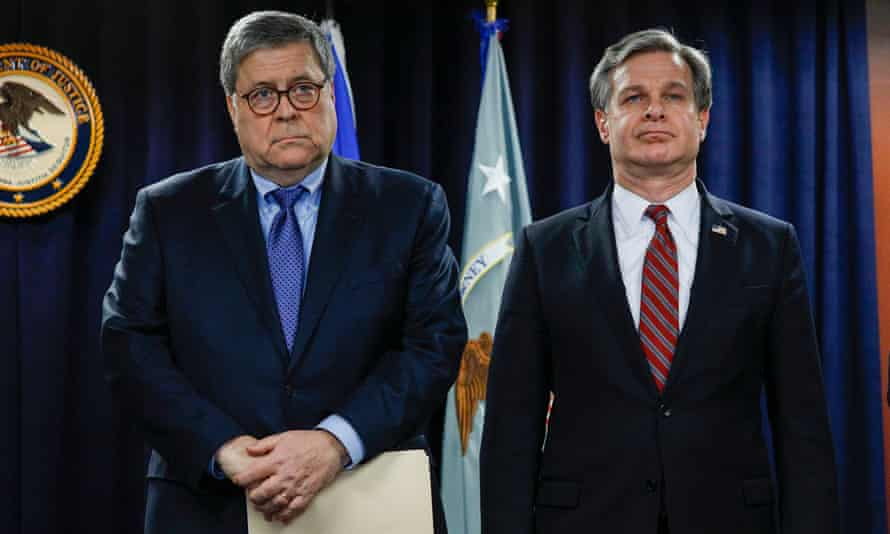 William Barr and FBI Director Christopher Wray on 18 December 2019 in Detroit, Michigan.
