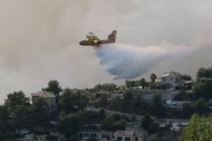 A Canadair drops water over a fire in Castagniers, near Nice, France
