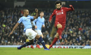 Fernandinho (left) tackles Liverpool's Mohamed Salah – the 33-year-old was in excellent form against Manchester City's title rivals.