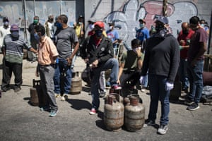 People from El Valle de Caracas parish queue for eight hours to buy a cylinder of butane gas during the second week of the national quarantine in Caracas, Venezuela, in late March.