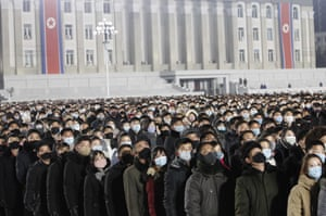 People watch a flag-raising ceremony and fireworks display in Pyongyang, North Korea