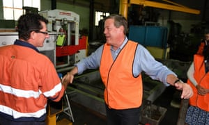Tim Nicholls introduces himself to a worker