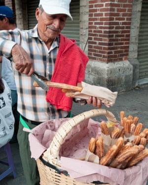 A churros-seller inOaxaca City, Mexico.