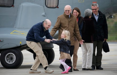 Nicolas Hénin (left), former French hostage and journalist, is greeted by his family following his release in April 2014
