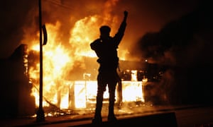 A check-cashing business burns during protests in Minneapolis.