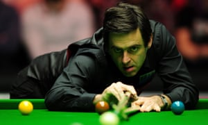Ronnie O'Sullivan plays a shot against Mark Williams in the first round of Masters