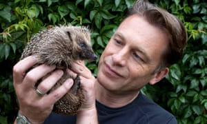 Chris Packham holding a hedgehog