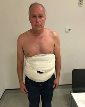 Jeffrey Lendrum with bird eggs strapped to his body in a sling after arriving in the UK at Heathrow Airport on June 2018.