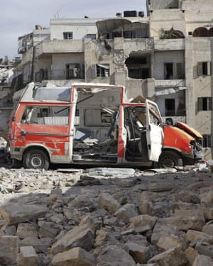 A destroyed ambulance is seen outside the Syrian Civil Defence HQ after airstrikes in Ansari.