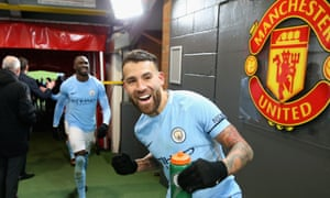 Manchester City's Nicolás Otamendi celebrates after leaving the field at Old Trafford. A scuffle broke out in the tunnel after the match.