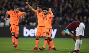 Mohamed Salah celebrates his second goal and Liverpool's fourth of the match.