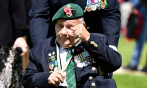 A Normandy veteran reacts after laying a wreath during the Royal British Legion's Service of Remembrance.