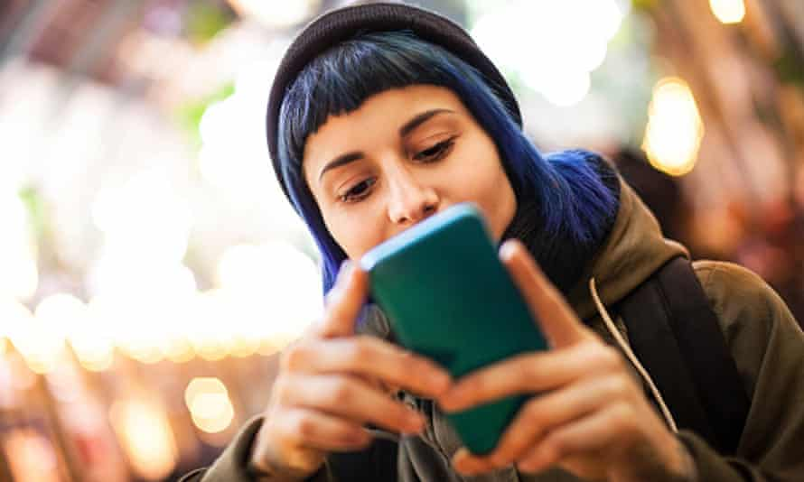 Young woman using smartphone outdoor