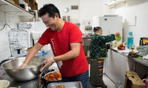 Loga and Dolma Yangchen in the kitchen of their Tibetan restaurant, Loga's Corner.