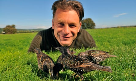 Chris Packham with starlings