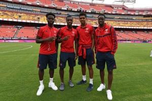 Bukayo Saka, Eddie Nketiah, Tyreece John-Jules and James Olayinka pose before Arsenal's game against Real Madrid in the International Champions Cup.