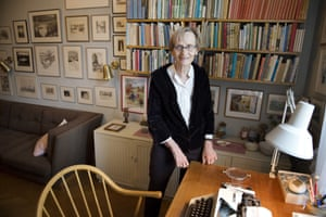 Astrid Lindgren's daughter, Karin Nyman, stands next to her mother's desk at her apartment in Stockholm.