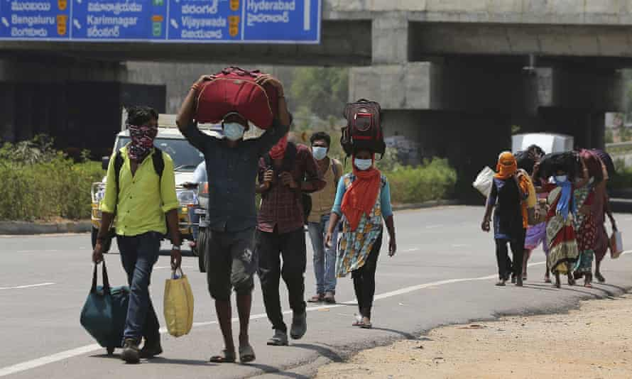 Migrant workers near Hyderabad try to return to their villages, perhaps hundreds of miles away.