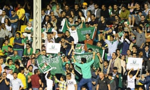 Saudi Arabia supporters – male and female – attend a friendly match at Craven Cottage in 2014.