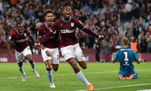 Aston Villa's Jonathan Kodjia (centre) celebrates his late equaliser as Brentford's goalkeeper Daniel Bentley despairs.