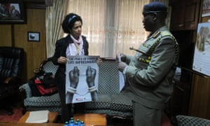 Paula Kahumbu delivers posters and presents a petition demanding the arrest of suspected ivory trafficker Feisal Mohamed Ali letter to the Inspector General of Police, David Kimaiyo, at his Nairobi office, 12 August 2014