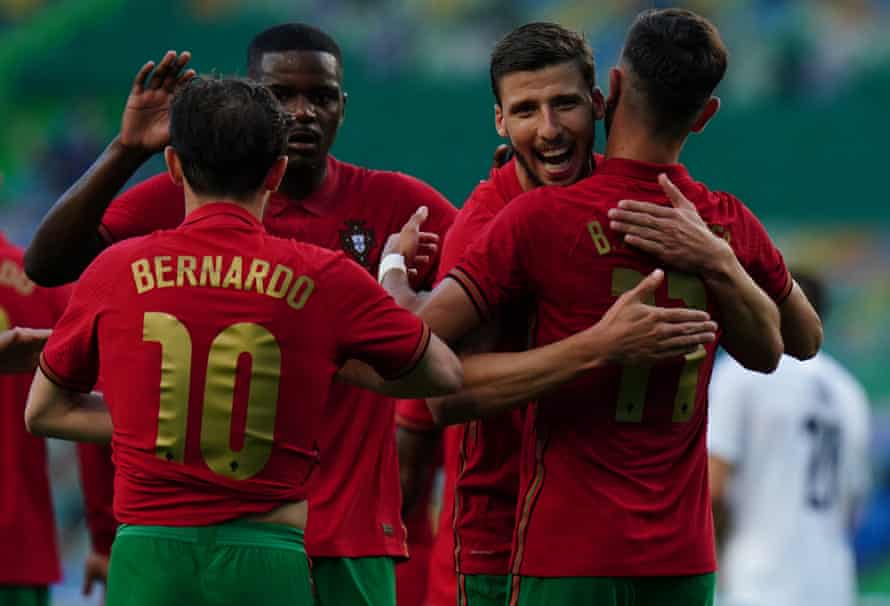 Bruno Fernandes celebrates with teammates after scoring for Portugal against Israel in a friendly on 9 June