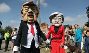 Protestors wearing Donald Trump and Theresa May paper mache heads join the protest in Butler's Cross, close to the prime minister's country residence of Chequers.
