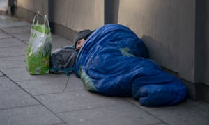 A homeless person sleeping on the streets