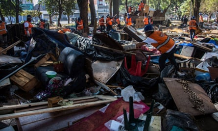 Municipal workers remove demolished shacks from Princesa Isabel square in Crackland after the latest police raids.