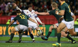 Danny Cipriani of England kicks the ball to set up a try for Jonny May.