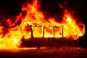 A bus burns in the downtown area after a mass fare-dodging protest