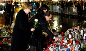 Paris mayor Anne Hidalgo accompanies German Chancellor Angela Merkel and French President Francois Hollande as they show their respects to the victims of the November terror attacks.