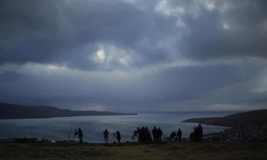 People wait for the eclipse in Torshavn, Faeroe Islands
