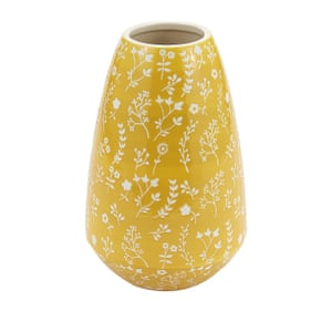 Yellow vase with white flowers