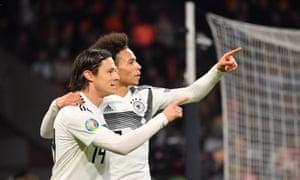 Leroy Sane (right) of Germany celebrates with teammate Nico Schulz.