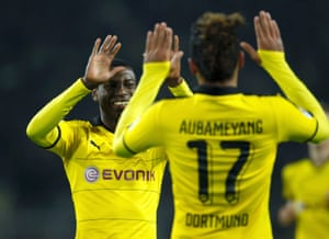 Two players give each other high-fives in the Borussia Dortmund v VfB Stuttgart match last month