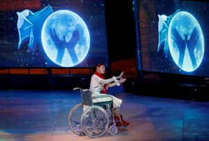 A young girl performs during the Beijing section of the Paralympic closing ceremony