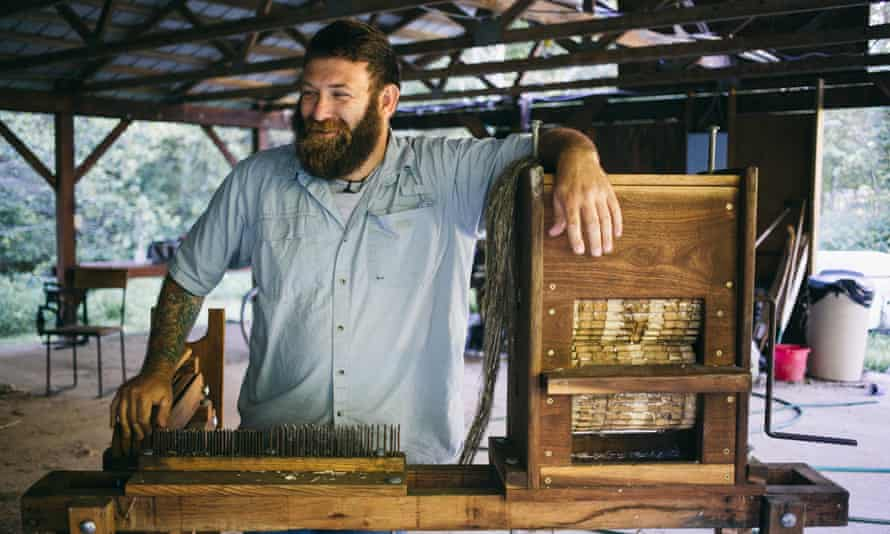 Michael Lewis with his special, one-of-a-kind hemp processing machine, called a break.