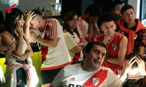 Supporters of Argentina's River Plate in a bar in Buenos Aires react after their team lost 2-1 to Flamengo in the Copa Libertadores final.