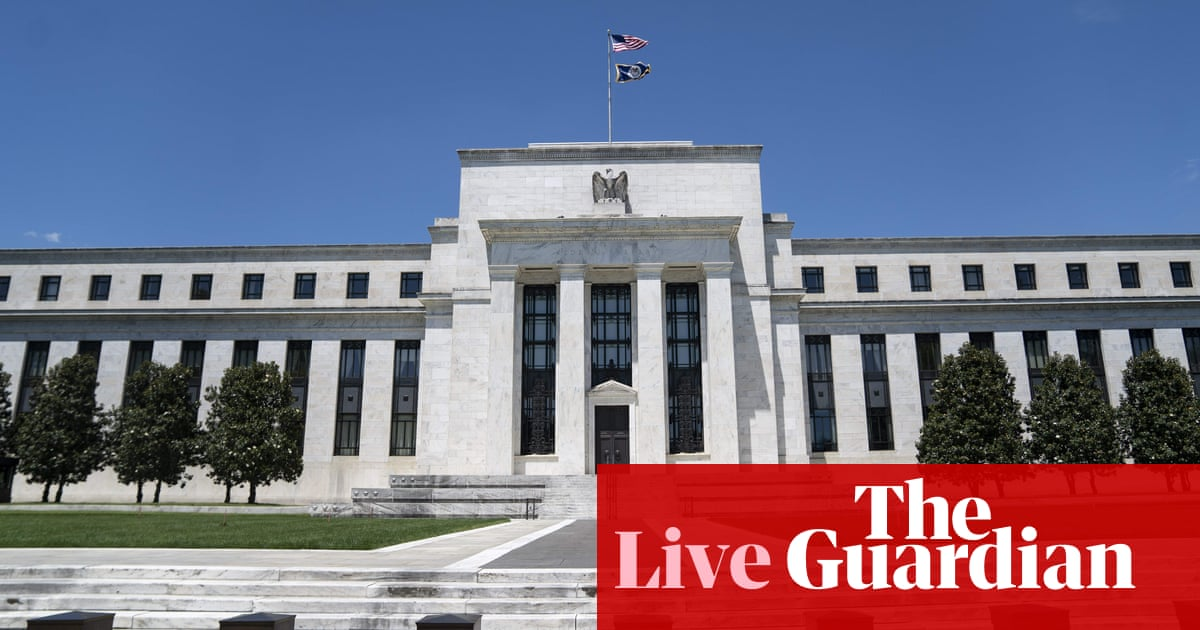 Stocks drop and dollar climbs after Federal Reserve signals earlier rate rise – business live